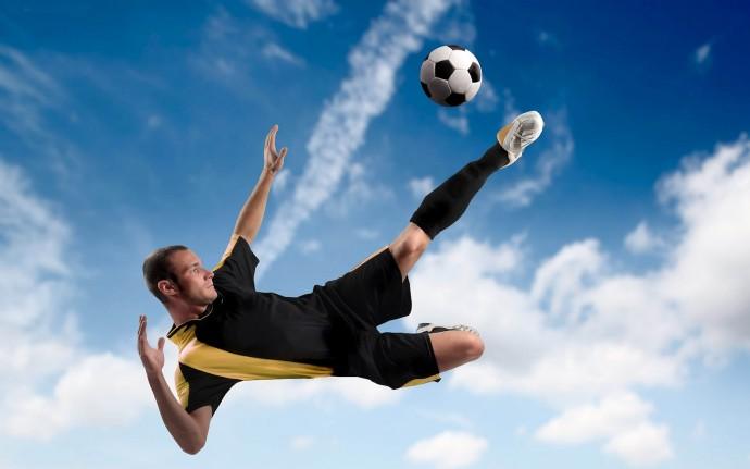 Soccer-Football-Wallpapers-football-player-jumping-sky-690x431_c